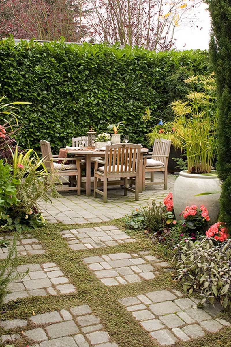 A Flagstone Patio Becomes Wide Border Of Stones And Step Able Ground Cover Between