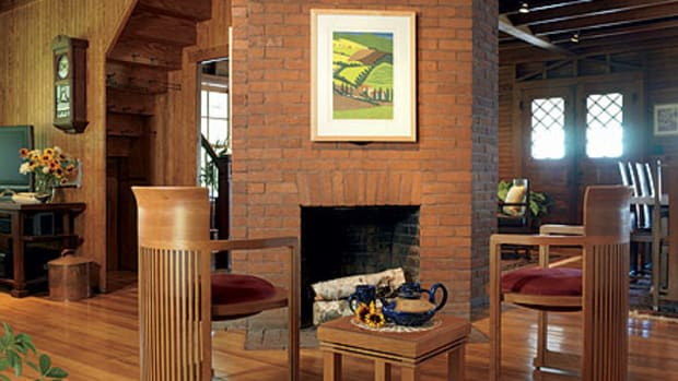 Wood flooring is the perfect backdrop in an old Adirondack lodge furnished with Copeland Furniture's exclusive reproductions of Frank Lloyd Wright designs. Photo by Carolyn Bates.