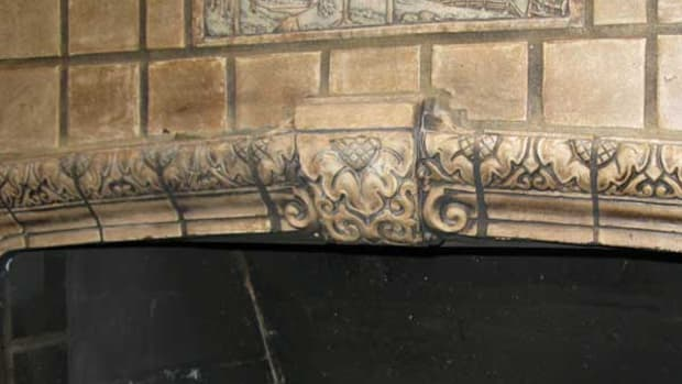 The keystone tile had been sheared off, probably to make room for a fire screen. Epopxy reconstruction was guided by a historic Claycraft catalog. Photos show repair, and after finish painting.