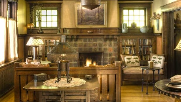 In a 1915 Prairie Style house, the living room's fireplace surround is composed of evenly spaced square field tiles in mottled browns and greens. Photo by Edward Addeo