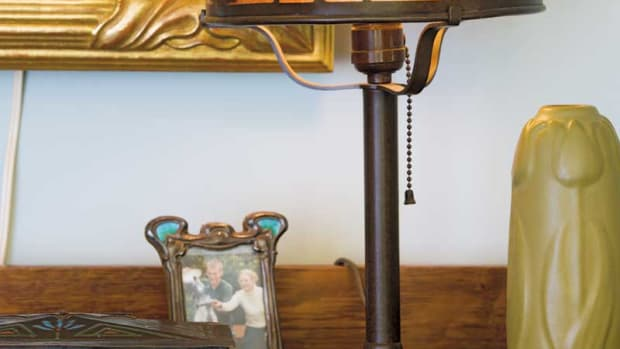 The lamp illuminating a bungalow bookcase is a cherished antique by Heintz. Phto: William Wright