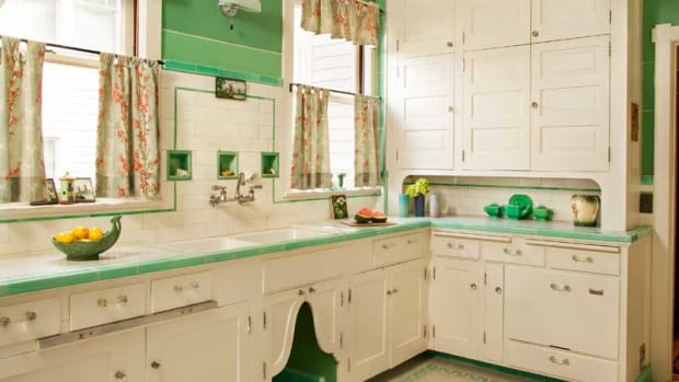 The pretty tile floor dates to the 1930 renovation; cabinets are likely original (1910). Nancy Conescu added the arched doors. Glossy green Marlite on the walls is ca. 1951. Photos by Blackstone Edge Studios
