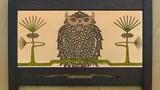 The art print in an Arts & Crafts dark oak frame is from Mission Guild Studio