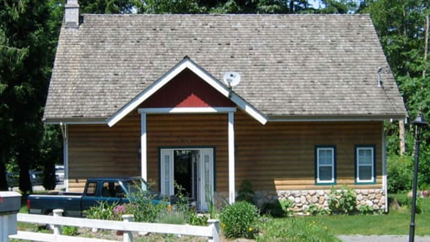 Before renovation, the house was a little faux-log cabin.