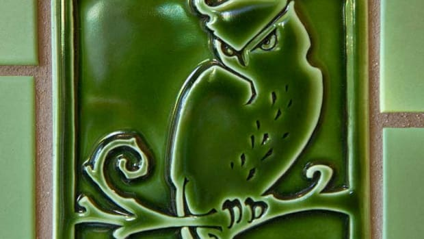 A detail of the owl decorative tile in an Evergreen gloss glaze.