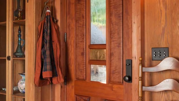 A custom entry by Mendocino Doors was fashioned from scarce, salvaged old-growth redwood.  Photos by William Wright