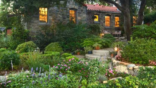 Spanish Colonial Revival with lush gardens