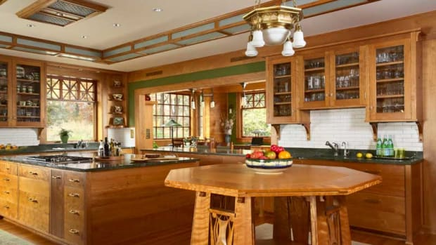 A large buffet anchors one end of the room, which opens to a dining area on the sunset porch.