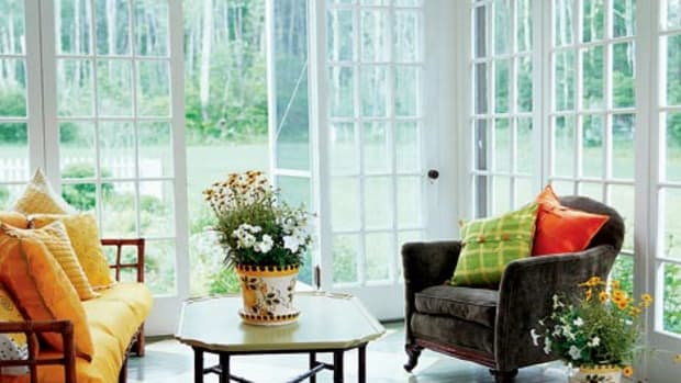 French doors used as panels are a great way to get an extra season out of a screened porch. Photo by Eric Roth