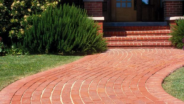 While brick is a traditional material for paths, brick pavers can stand up to the weather better than bricks made for other purposes. (Photo: Doug Keister)