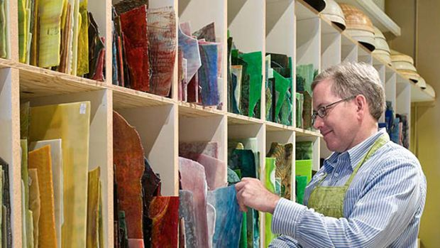 Bill Campbell of Century Studios keeps a stock of fine American-made, hand-rolled opalescent glass, the same glass Tiffany used. Photo by William Wright.