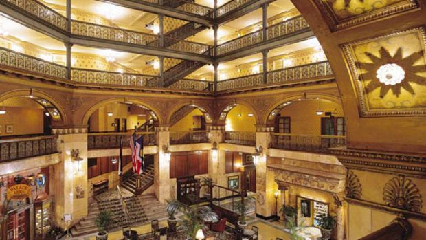 The eight-story atrium at the 1892 Broan Palace Hotel features cast-iron grillework.