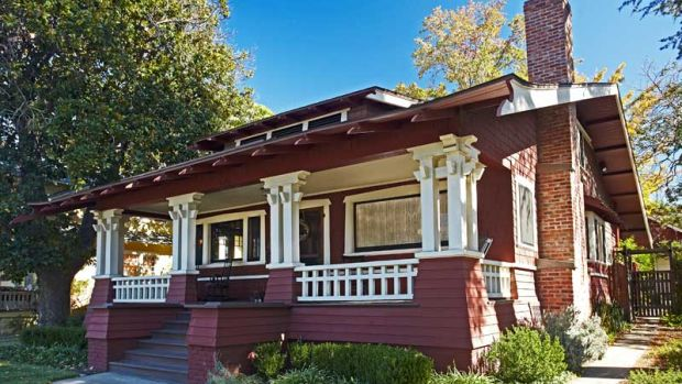 Bold trim enlivens the shingled exterior of this 1909 Wilson Plan bungalow.