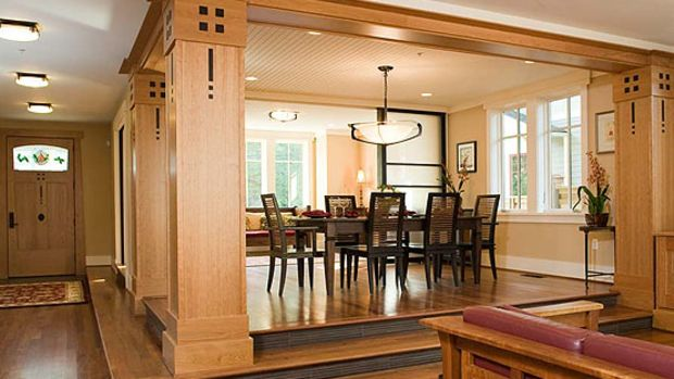 The temple-like dining room is elevated, giving it special importance: Frank Lloyd Wright would have approved.
