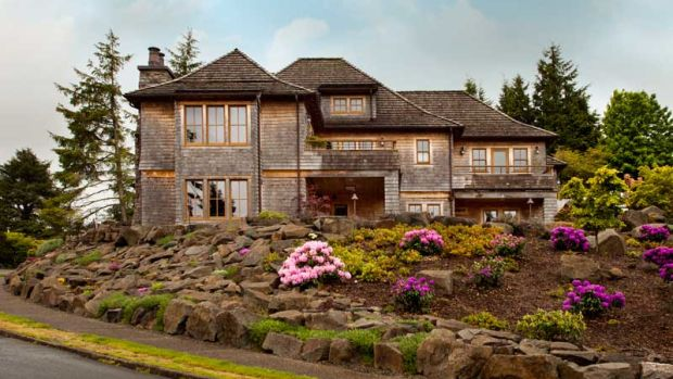 Though the front of the house is cabin-like, the rear has Shingle-style elements.