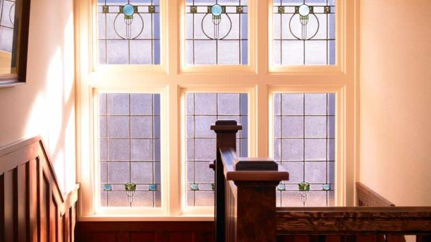 This restrained but decorative leaded-glass ensemble was discovered in the 1912 house during restoration, and re-installed. The large wood dividers between windows are called mullions.