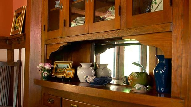 The built-in buffet of Douglas fir is a notable feature with fine details: hexagonal pilasters with a heavy lintel, flared serving shelf, beveled mirror.