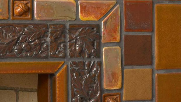 Fireplace tile surround installation by Pewabic.