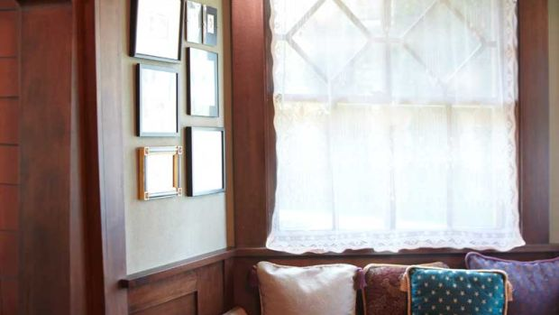 Original millwork in a 1908 Prairie-style house includes this window seat in a bay. Photo: Scott Van Dyke
