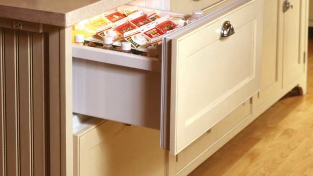 A refrigerator drawer in a kitchen by Crown Point Cabinetry.