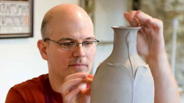 Founder and president Kevin Hicks in the studio, working on a 'Revival' vase.