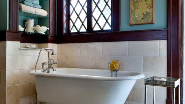 The slipper tub looks as though it has been in place forever; it was salvaged and relocated from a different bathroom in the house. Photos by Gross & Daley