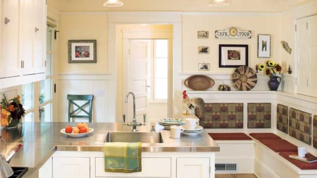 The era's white kitchens were interpreted for this Oregon Foursquare; the banquette incorporated the original wainscot. Photo: William Wright