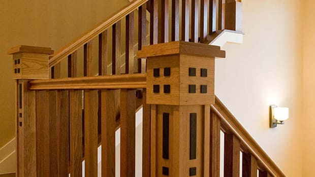 """A familiar """"four squares"""" motif repeats on the handsome staircase. Photo by Erick Gibson."""