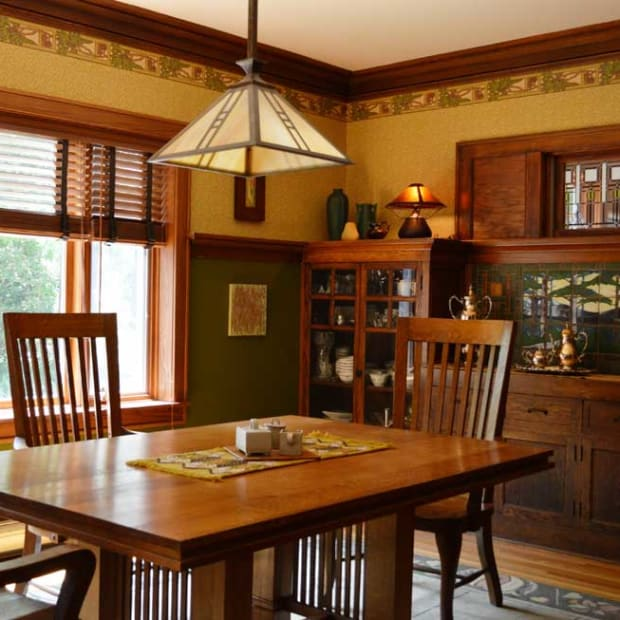 "Prairie-style leaded glass in the transom and a tile ""mural"" enliven the sideboard."