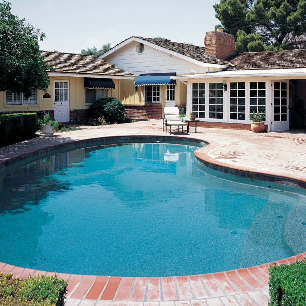 Kidney shaped pool ranch house