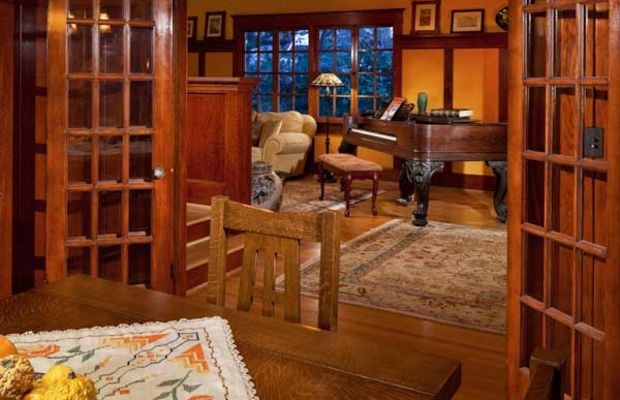 The dining room flows into the living room when French doors are open.