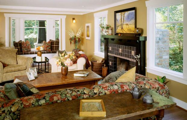 Craftsman design elements were used consistently, inside and out. White paint updates the look of period-inspired woodwork, including interior colonnades with battered posts. Fireplace tiles are by Pratt and Larson.