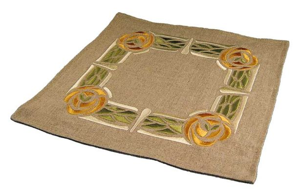 The embroidered tabletop linen is recent work, from Ford Craftsman Studios.