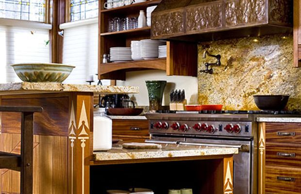 With a counter-height back, the large island acts as a fourth wall to separate the kitchen from the living area.