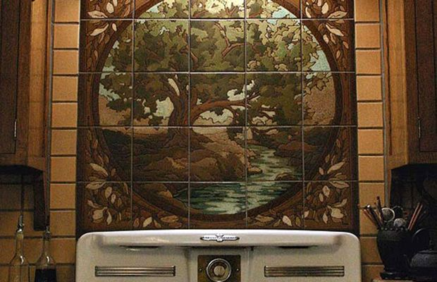"""Individual art tiles make up a mural or tile """"painting,"""" this time behind a vintage stove. Courtesy RTK Studios."""