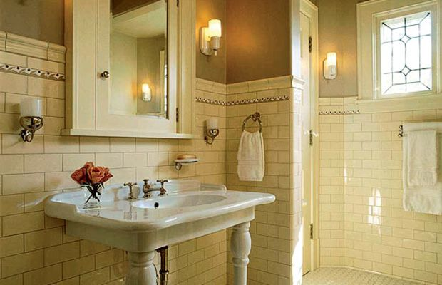 The white-tiled bath, here with hex floor tiles and a high wainscot of subway tiles, is a Belle Epoque classic enjoying a revival. The 1920s look works for houses 1890–1930s. Photo by Karen Melvin.