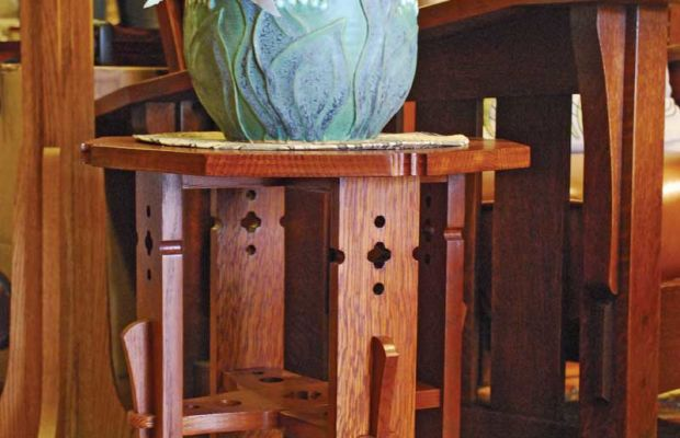 A Rohlfs-inspired tabouret holds  a jardinière with a lily-of-the-valley motif; both represent new work available at Nest & Co.