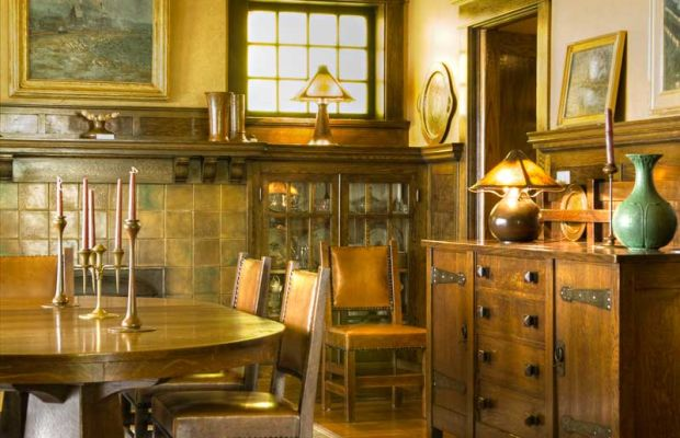 In a 1915 Prairie-influenced Foursquare, the home of an avid collector, antiques include the sideboard, dining table, and chairs, all early pieces by Stickley. The reproduction rug is a Voysey design. Photo: Edward Addeo