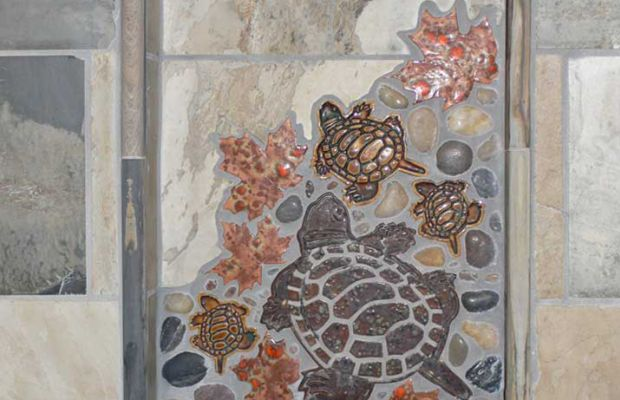A collage of free-form tiles decorates the shower niche.