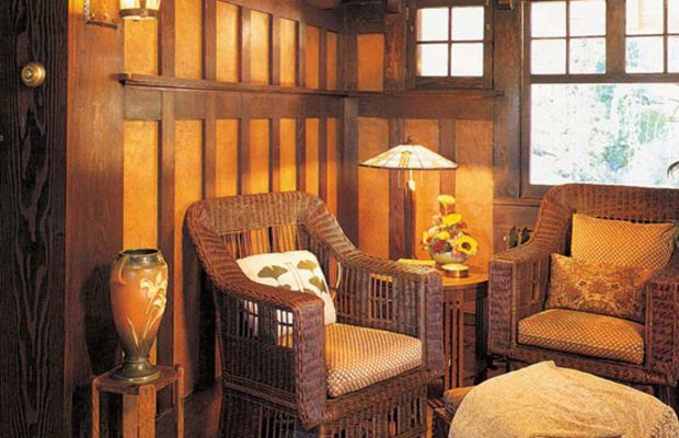 A high, two-tiered wainscot in an alcove retains its original leather-like wall covering under the battens. Photo by Douglas Keister.