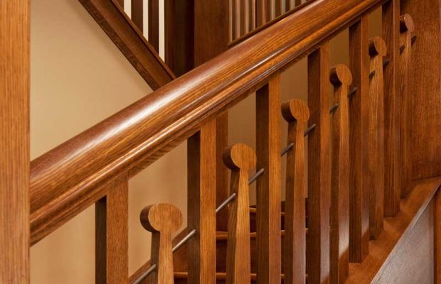 Whimsical balusters repeat a motif common to some Voysey-inspired homes.