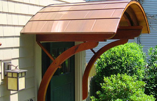 A door hood in copper with period-style support brackets. (Paradigm Shingles)
