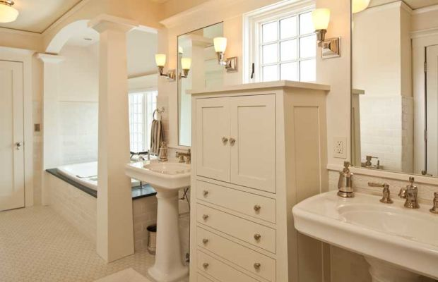 The boys' bathroom includes dresser-like built-ins.