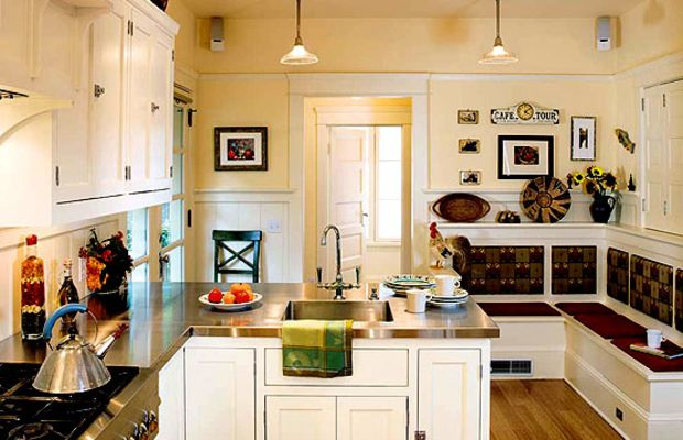 Here's a crisp interpretation of the era's white kitchens in an Oregon Foursquare; the banquette was built from original wainscot. Photo by William Wright.