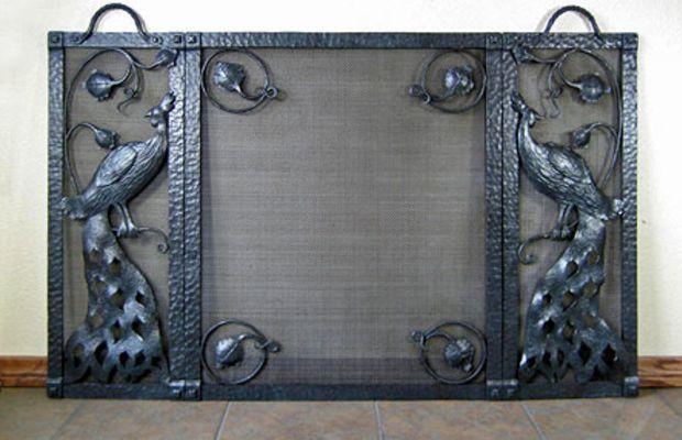 Peacock firescreen by Bushere & Son Iron Studio.