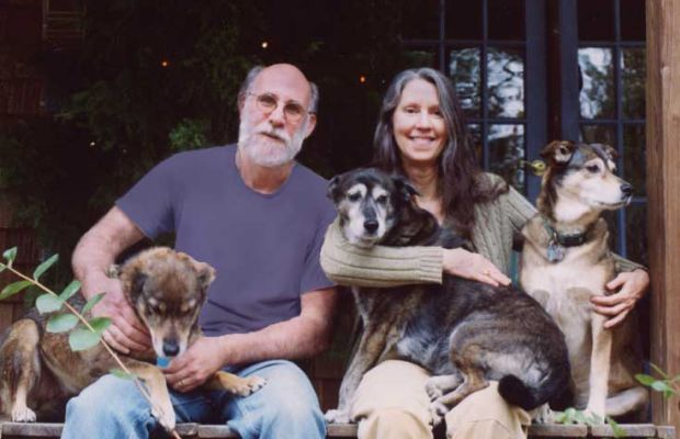 Gary Cargile and Elizabeth Whitfield-Cargile with their three dogs.