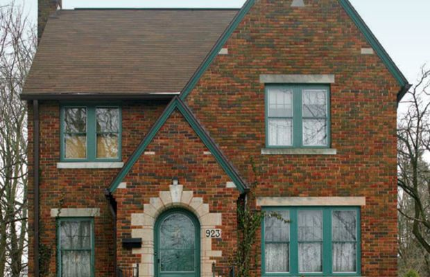 The modest Tudor Revival house, built in 1926, charmed these owners with its brick exterior and arched front entry.