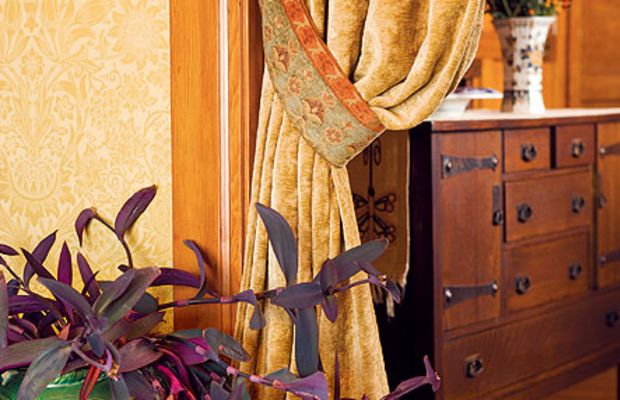 Chenille and damask portieres in a Tacoma (Wash.) home divide dining room from entry. Photo by William Wright.