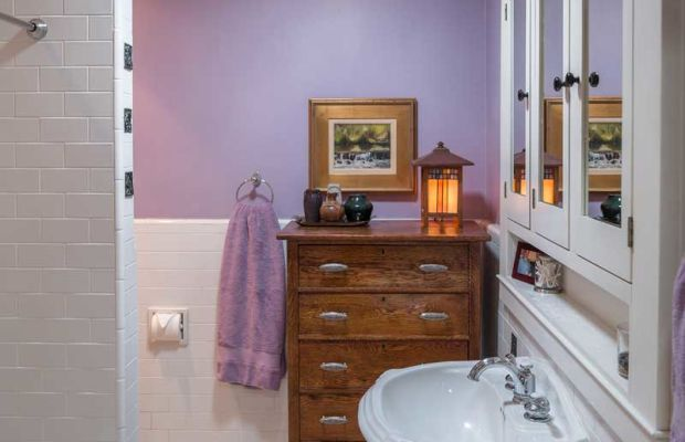 In the bathroom, only the tub was original, so the room was overhauled in period fashion. The medicine cabinet is based on a 1916 original.