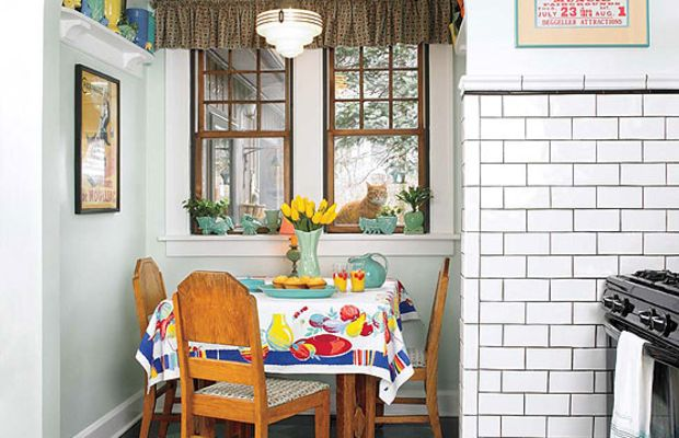 The original breakfast nook gets everyday use. A vintage tablecloth covers a 1930s table that came with matching chairs.